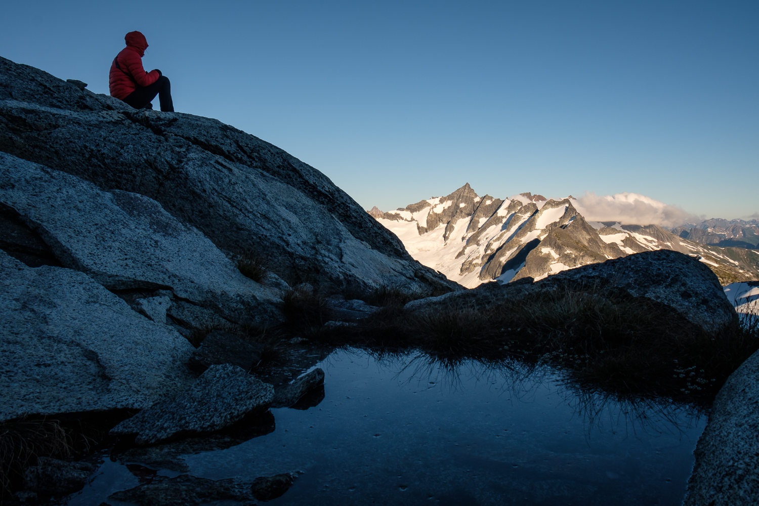 Enjoying the afternoon light on Torment and Forbidden from camp beneath the summit of Eldorado Peak, North Cascades National Park.