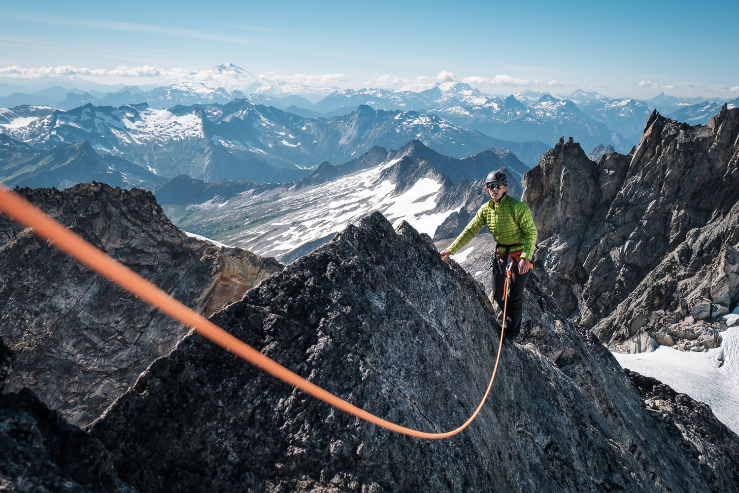 Becca on one of the au cheval sections of the NW ridge of Dorado Needle, with Baker and Eldorado in the background. North Cascades National Park.