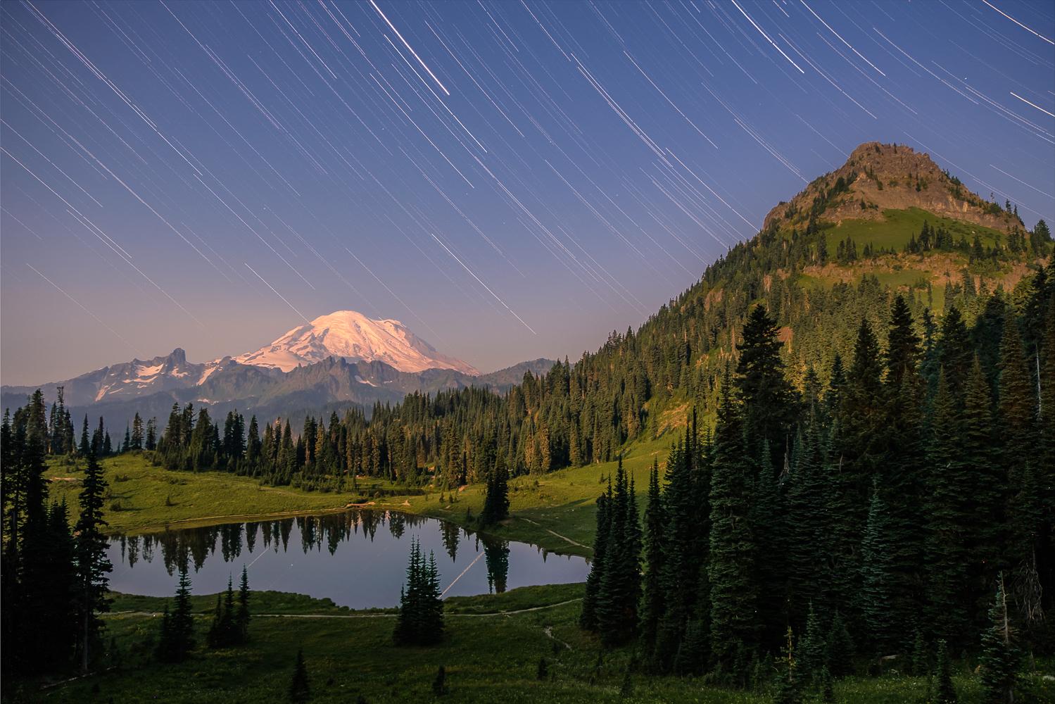 A full-moon timelapse of the night sky above Tipsoo Lake, Mount Rainier, and Yakima Peak.