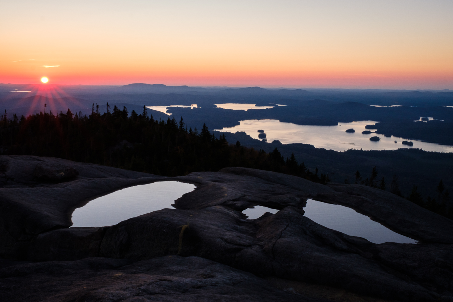 Sunset on Ampersand, looking out over Middle Saranac Lake, NY.
