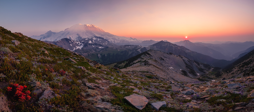 Wildfire smoke makes for a incredible sunset on Mount Rainier from beneath the summit of Mount Fremont. The sun is setting directly above Sluiskin Mountain.