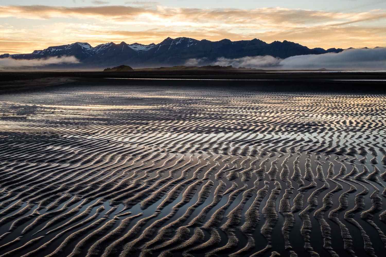 Sandy ripples and mountains on the Laekjavik coast