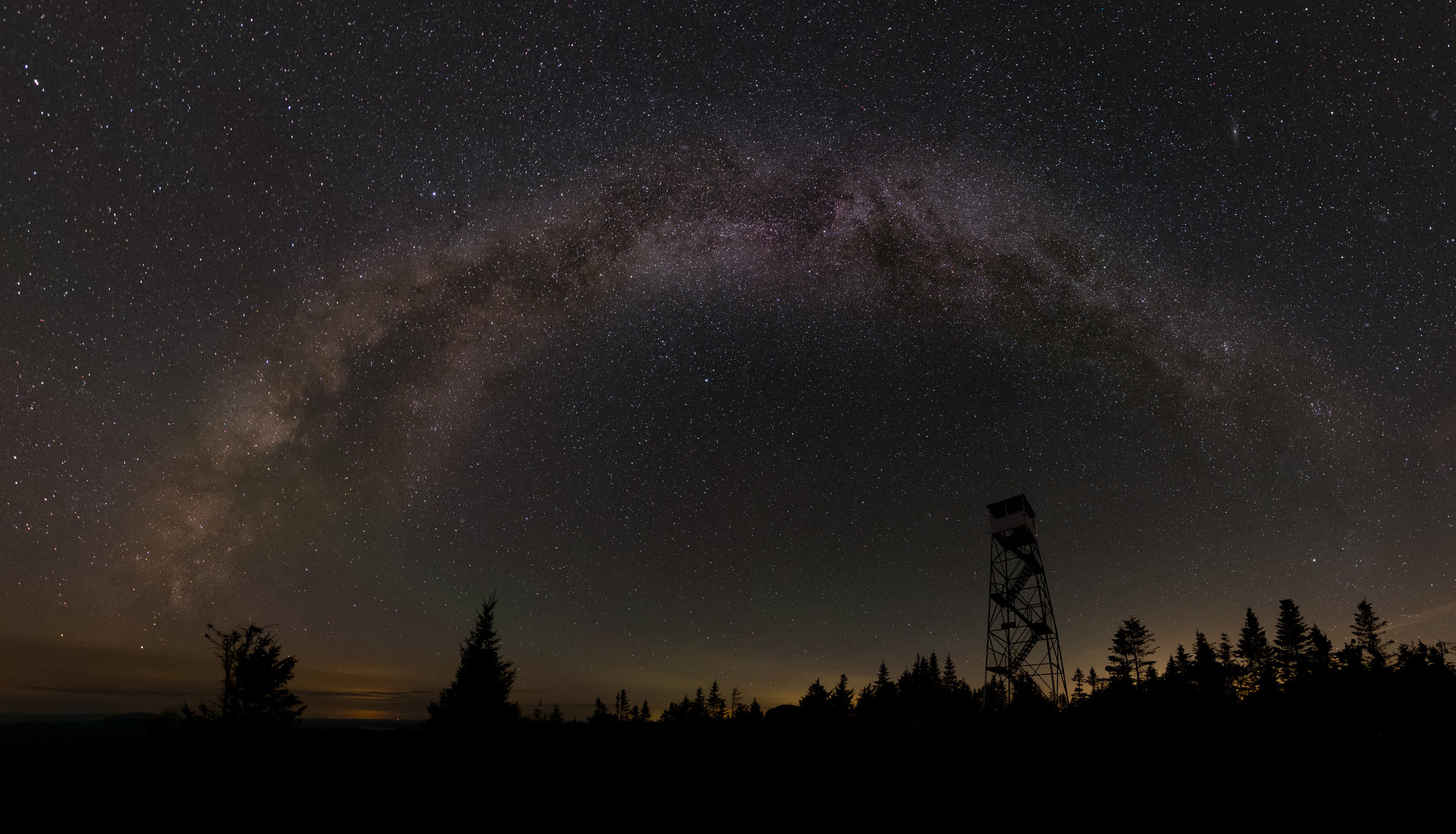 The Milky Way over the Saint Regis Mountain firetower.