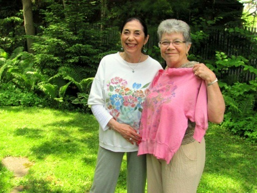 "Angie greets a longtime fan of her floral sweatshirts while wearing one of her own original designs!  ""Our 55th anniversary visit to your area was special. So pleased that you were home to check out my 1987 pink shirt! All the best for continuing health and happy times""  - Margaret (& Ron) Madill"