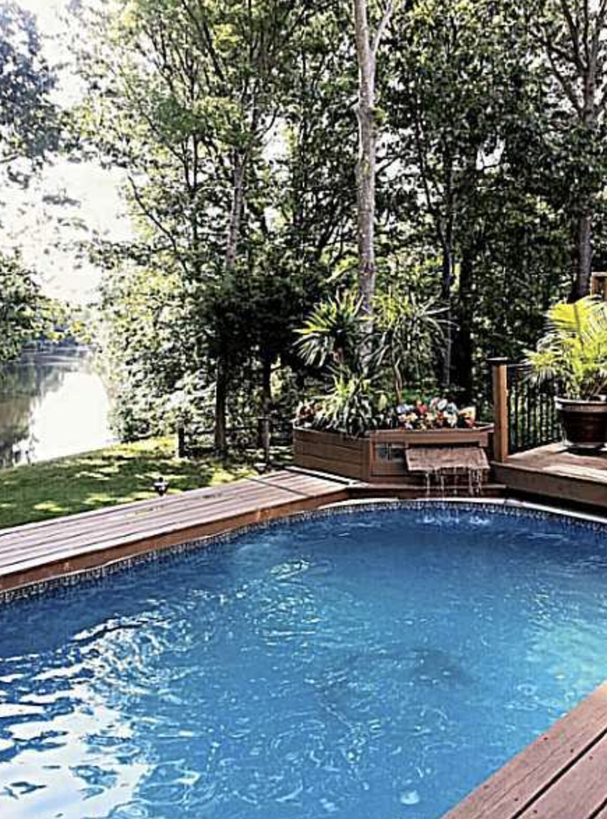 114 MILLERS COVE - BEAUTIFUL CUSTOM BUILT BRICK HOME ON LAKE WITH A POOL