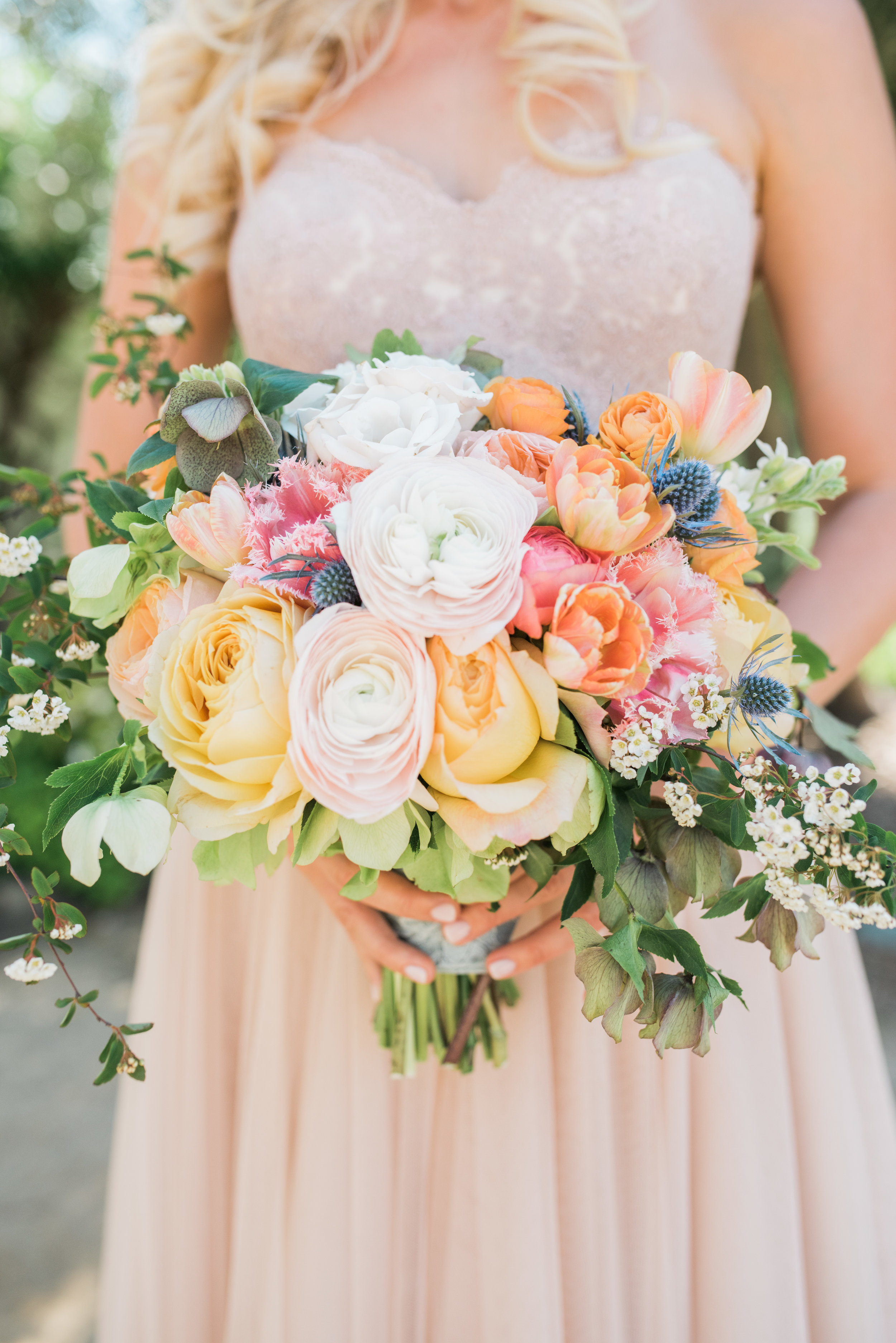 Photography -  Jillian Rose Photography   Blush Clooney Ranunculus - Spring  Orange Double Tulip - Spring/Summer/Winter  White Spirea - Spring  Coral Queensland Fringed Tulip - Spring/Summer/Winter  Green/Purple Hellebores - Spring/Winter  Blue Eryngium - Year Round  Yellow Caramel Antique Garden Rose - Year Round  Orange Ranunculus - Best in Spring (Available but smaller heads the rest of the year)  White Tweedia - Spring/Summer/Fall