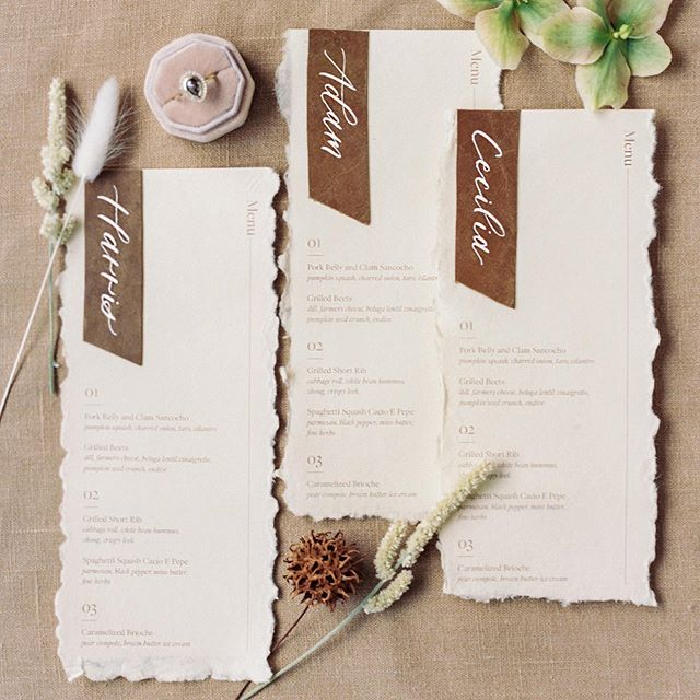 Leather layered on handmade paper 😍 I love playing with different textures and mixing calligraphy with sans serif type. . Planning & Design : @barielexaevents Venue & Wine : @cerfclub Photography : @oliviarichardsphoto Florals : @ashandoakfloral Stationery : @thebrightlinestudio Hair & Makeup: @bayareabeautiful Bridal Attire & Accessories: @loho_bride Rentals : @theonicollection Ring : @gembreakfast Cake : @prettypleasesf Napkins : @latavolalinen Model : @byalysamonet Videography : @amyhungfilms Dress Designer : @rime_arodaky Jumpsuit Designer : @lein_studio . . . #menus #weddingdesign #sfwedding #bayareawedding #menudesign #placecards #stationerydesigner #modernwedding #neutralwedding #dailydoseofpaper #calligraphycommunity #fineartwedding #weddingmenu #moderncalligraphy #weddingstationery #weddinginspiration #calligraphy #calligraphydaily #fineartcalligraphy #stationeryaddict #customcalligraphy #handmadepaper #creativepreneur #weddingdetails #weddinginvitations #texture #weddingcalligrapher #stationerylove #leatherwedding #leather