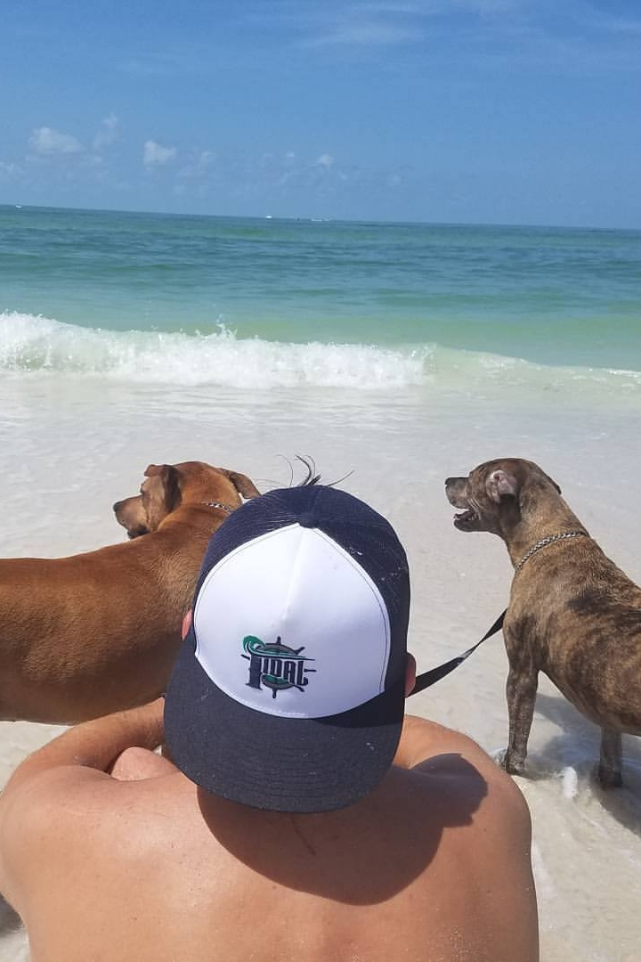 Dave taking a break at the beach with the brewery mascots. (And hiding from our photographer Allisa and her camera.)