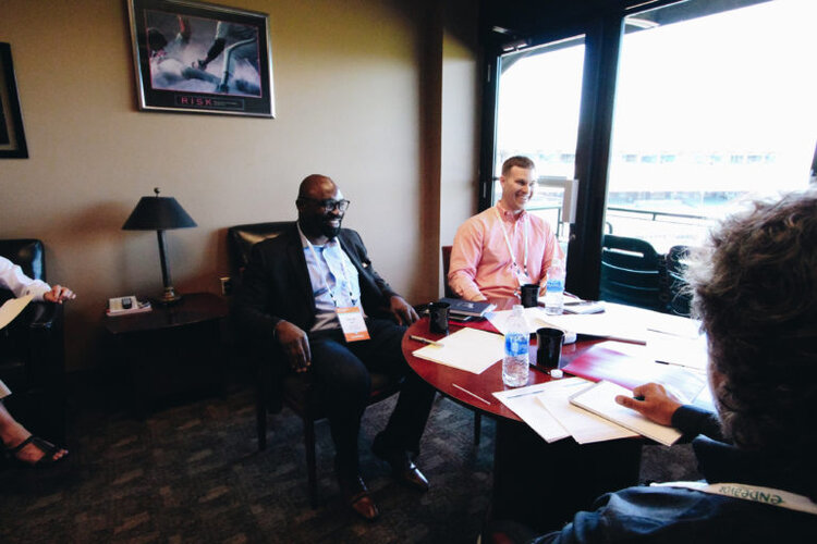 George Azih (left) interviews at Endeavor's 79th International Selection Panel in Louisville, where he was selected into the Endeavor network in 2018. | Photography by Jess Amburgey