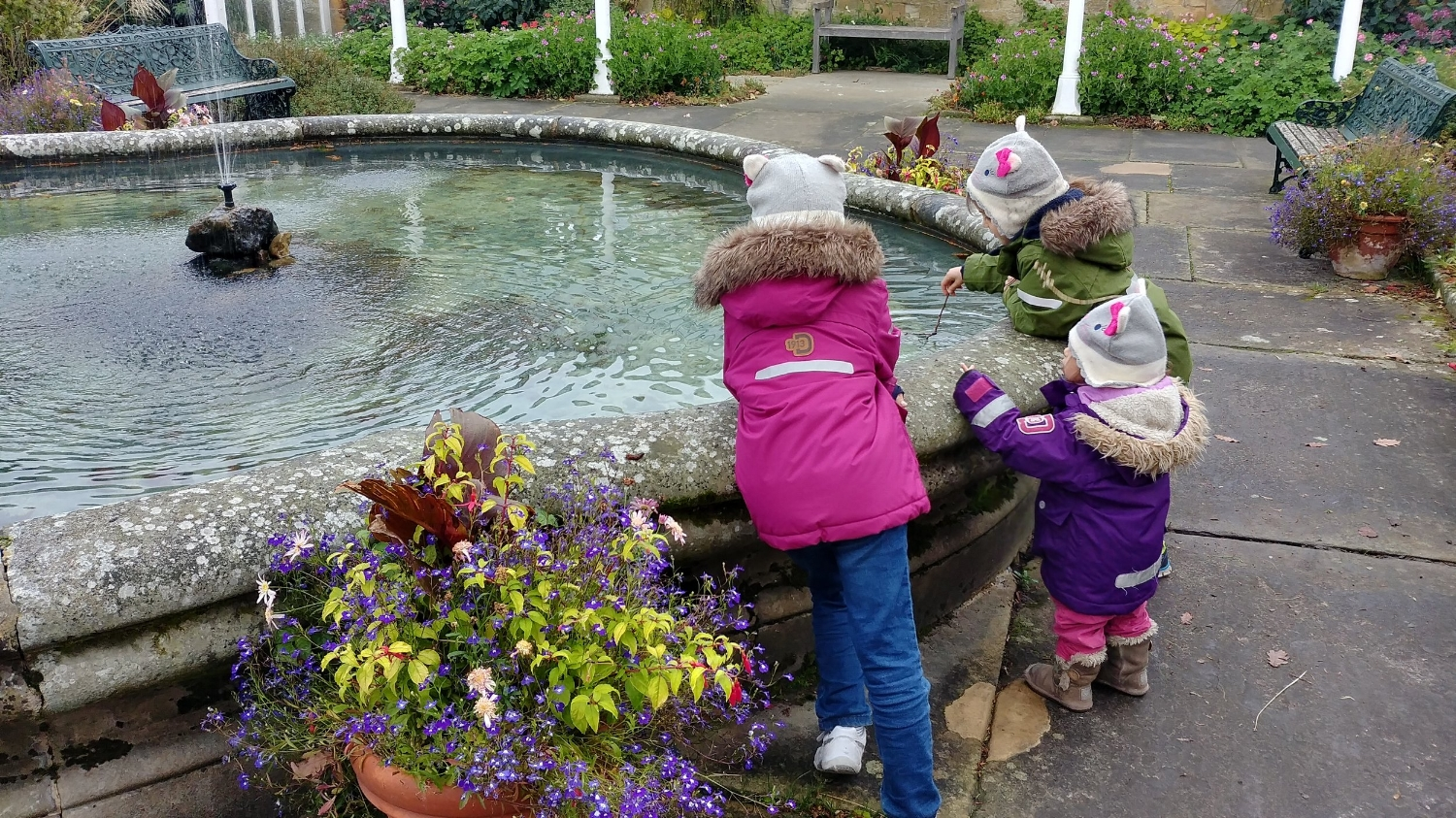 Fishing for coins in the National Trust fountain, little scroungers.