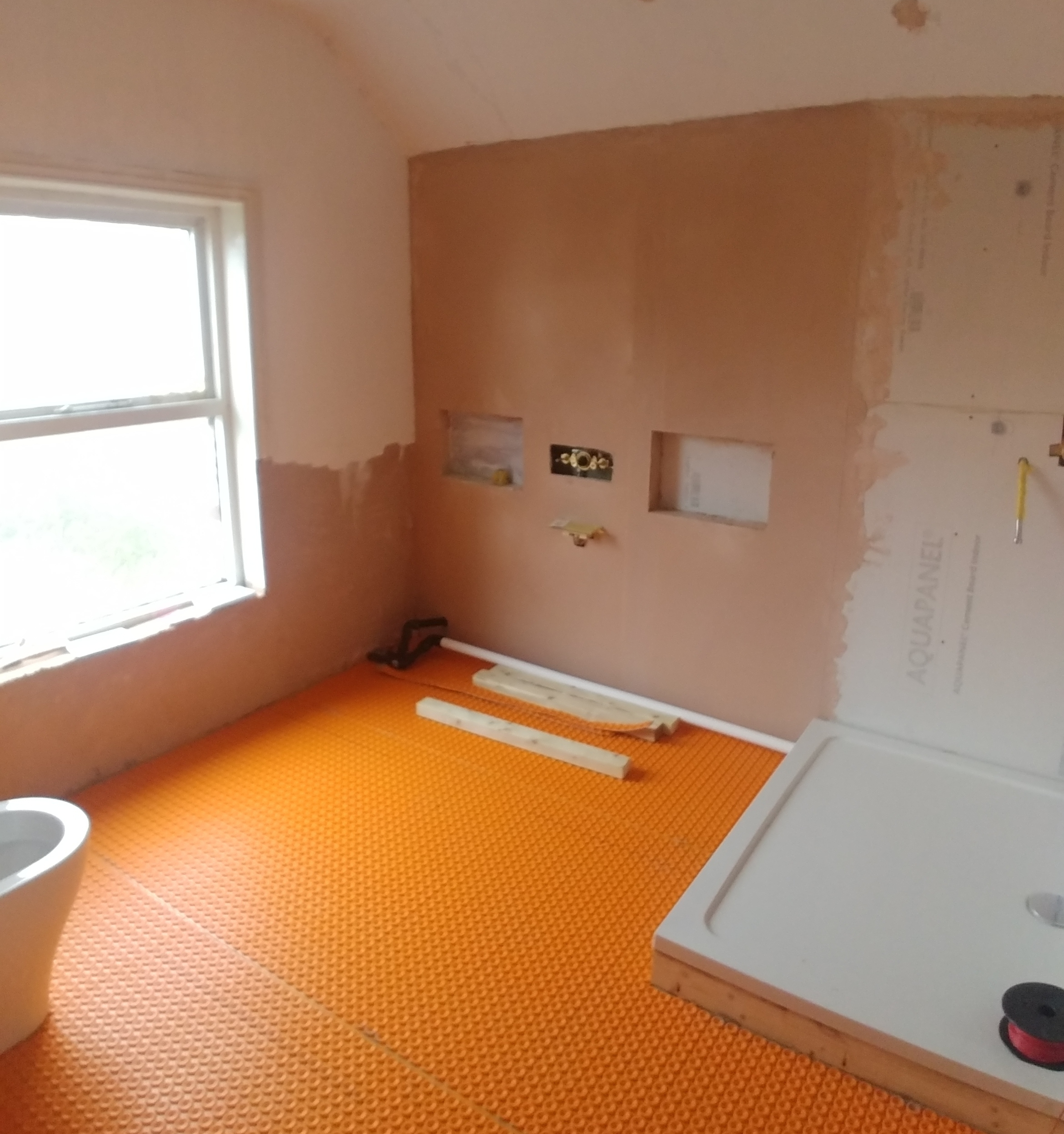 Ditra matting for the underfloor heating wire, plus shower base.