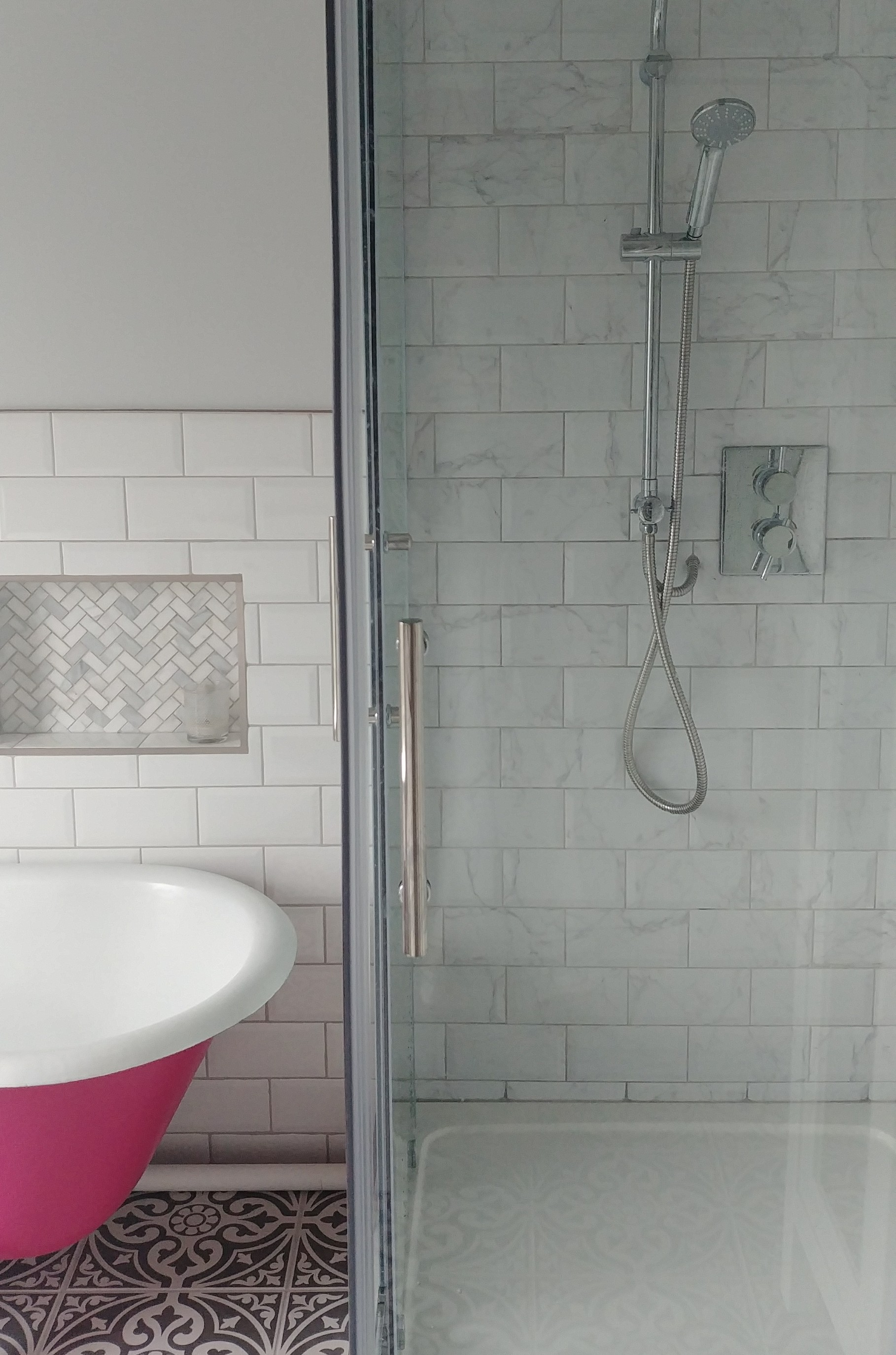 I matched up the white metro on the left with the faux marble within the shower enclosure.