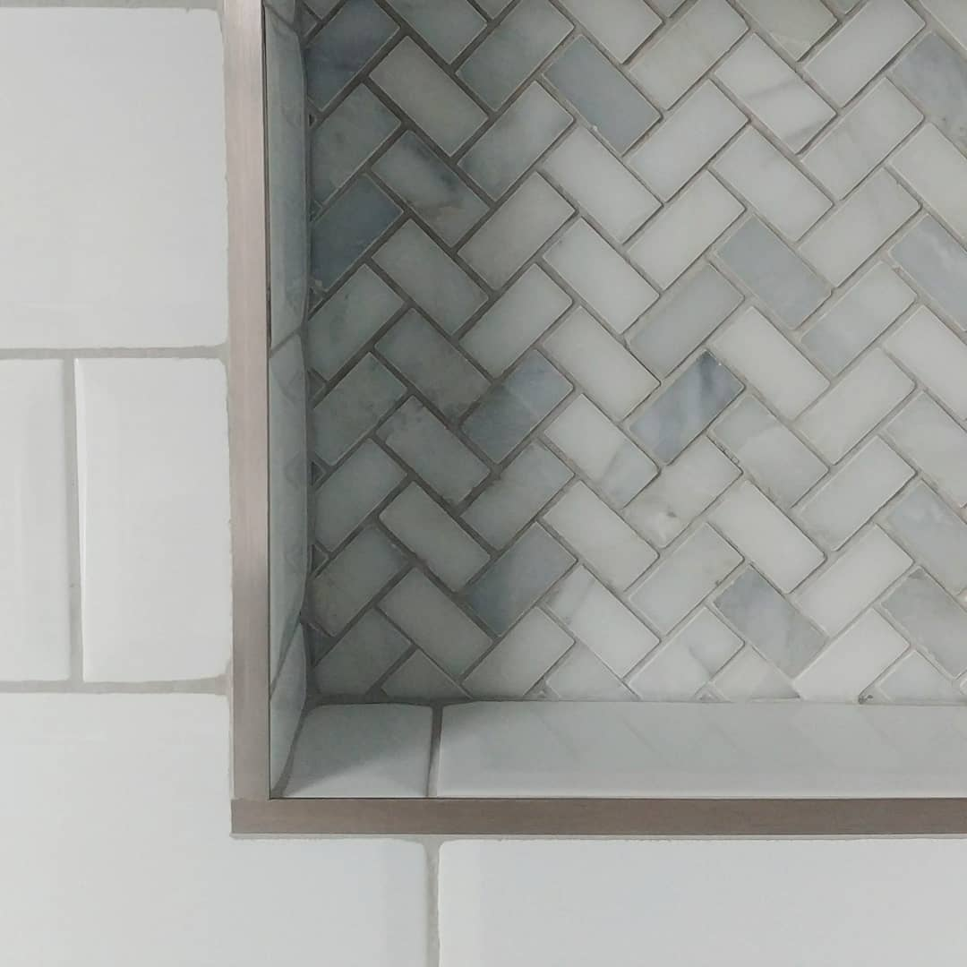 We used real marble herringbone in the alcoves above the bath. I trust you will also notice that the metro tiles on the alcoves sides *perfectly* match the metro tiles on the wall (she says, happily).