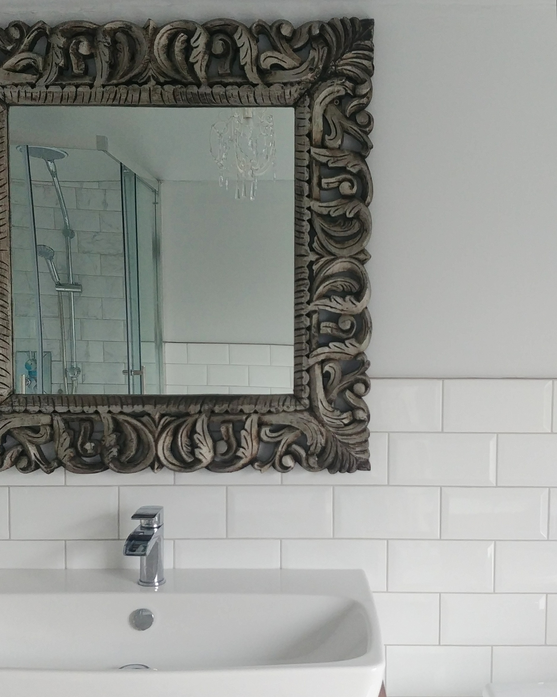 The shower and chandelier reflected in the mirror above the sink. I looked all over the internet for a suitable carved mirror and then realised we had the perfect option hanging in our hallway, which we purchased on holiday in the south of France eight years ago.