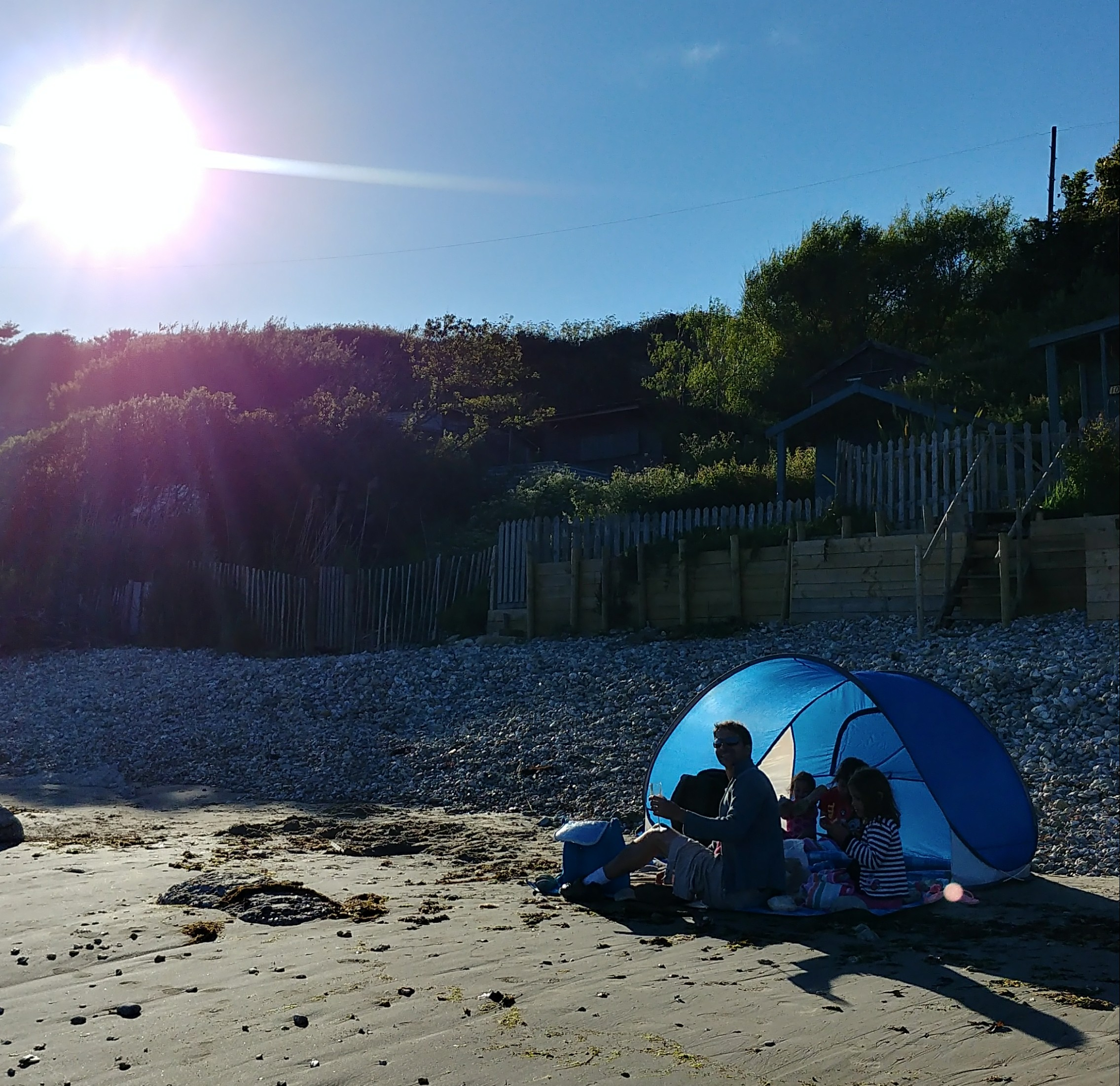 Fish, chips and prosecco on Forelands beach at sunset.