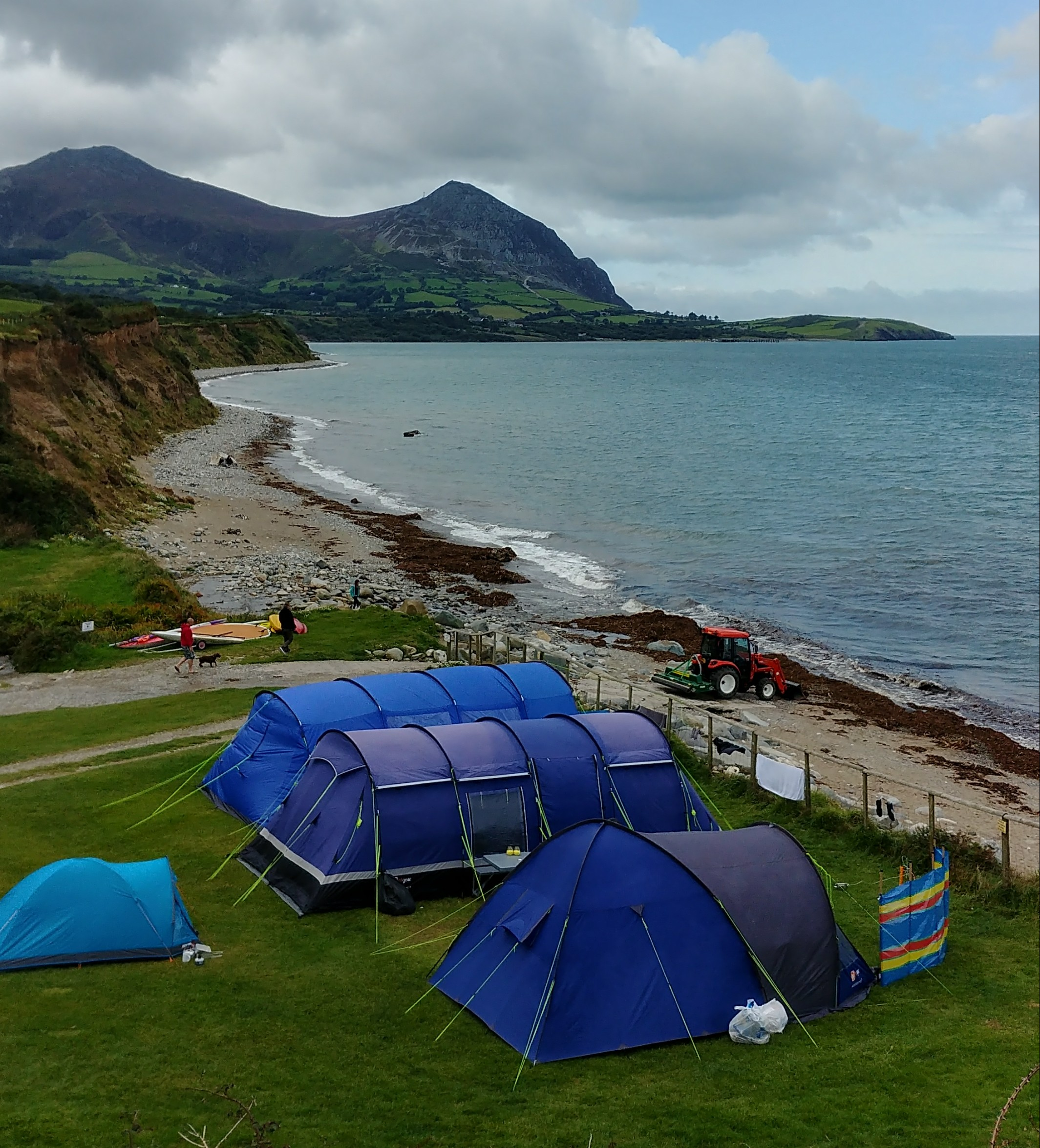 Aberafon campsite in north Wales. You can camp basically on the beach. Don't, because your tent will be ripped to shreds by the wind, but you can if you want to :-)
