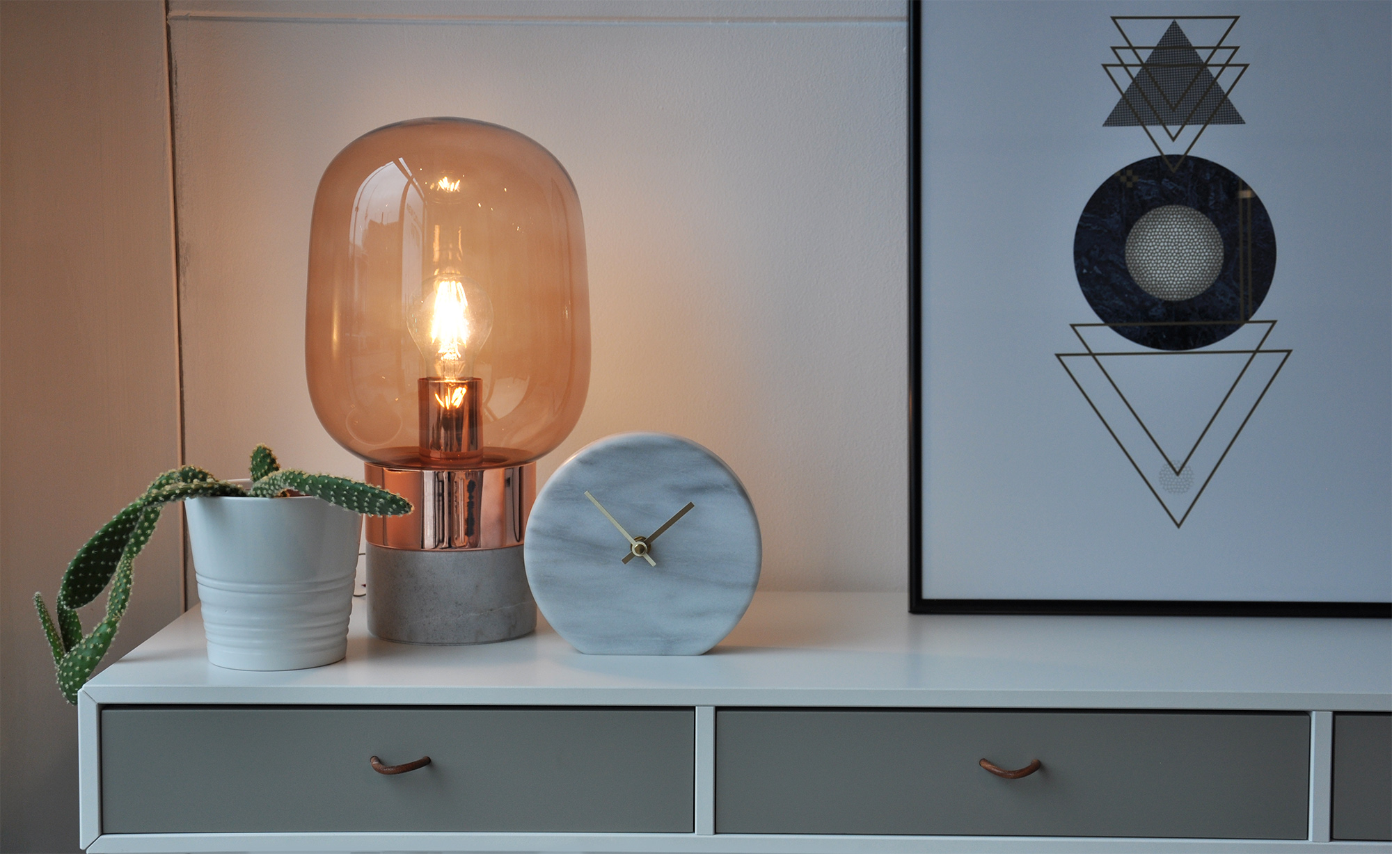 Circle marble clock ,  Stockholm lamp ,  Cupertino Console .