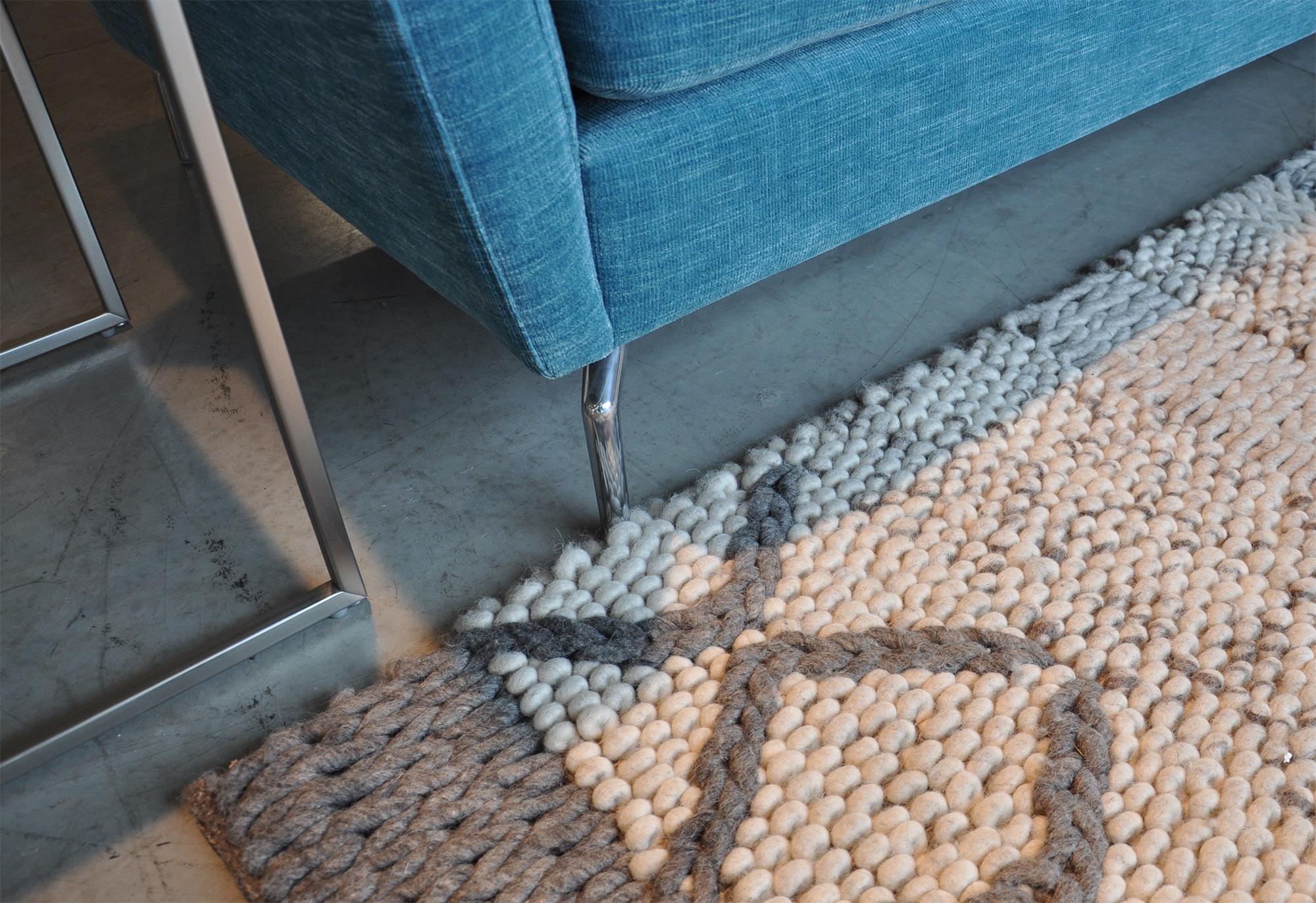 Palencia rug ,  Osaka sofa  in turquoise Napoli fabric.