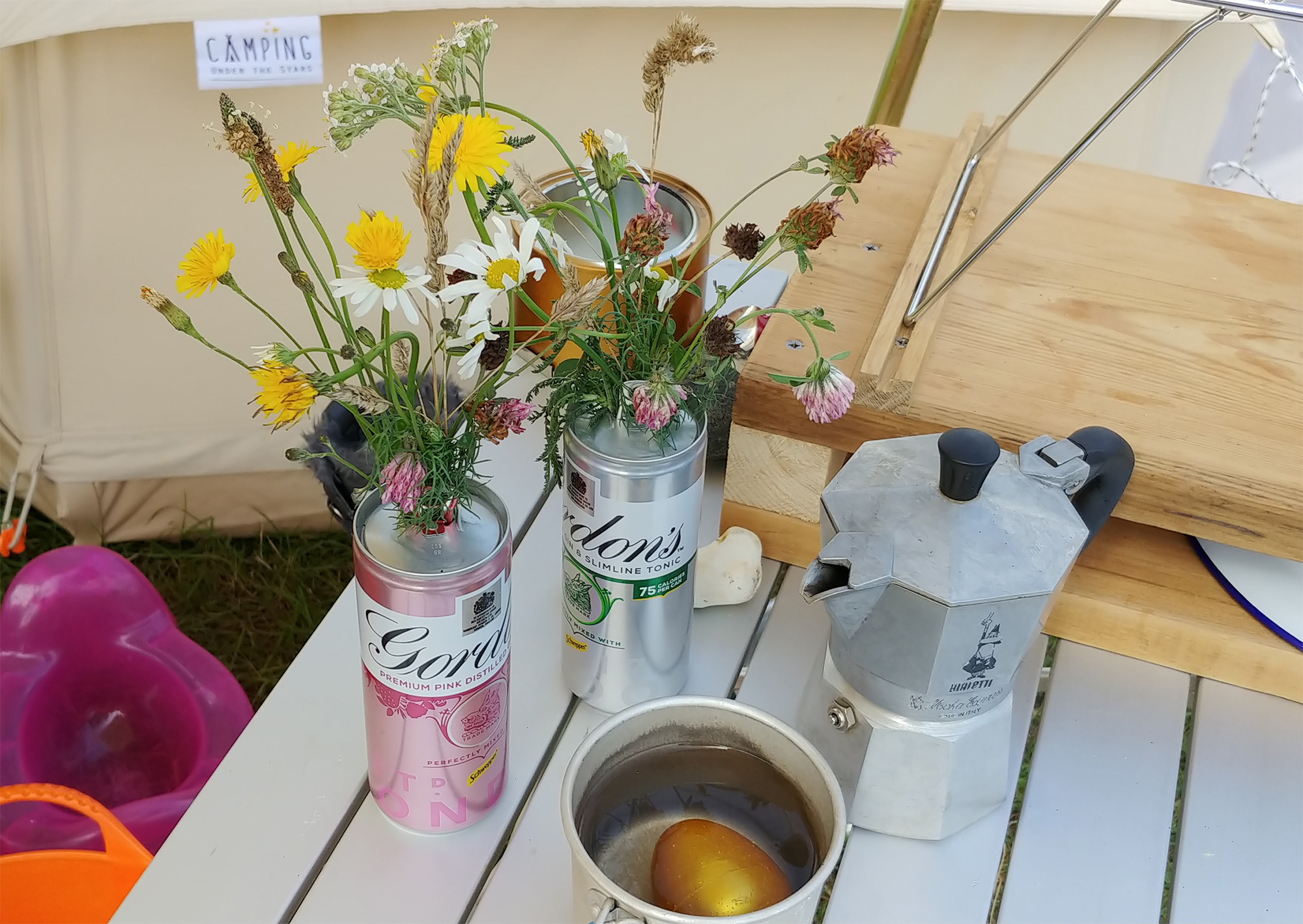 Wildflowers in gin tin vases :-) Plus a golden dinosaur egg, obviously.