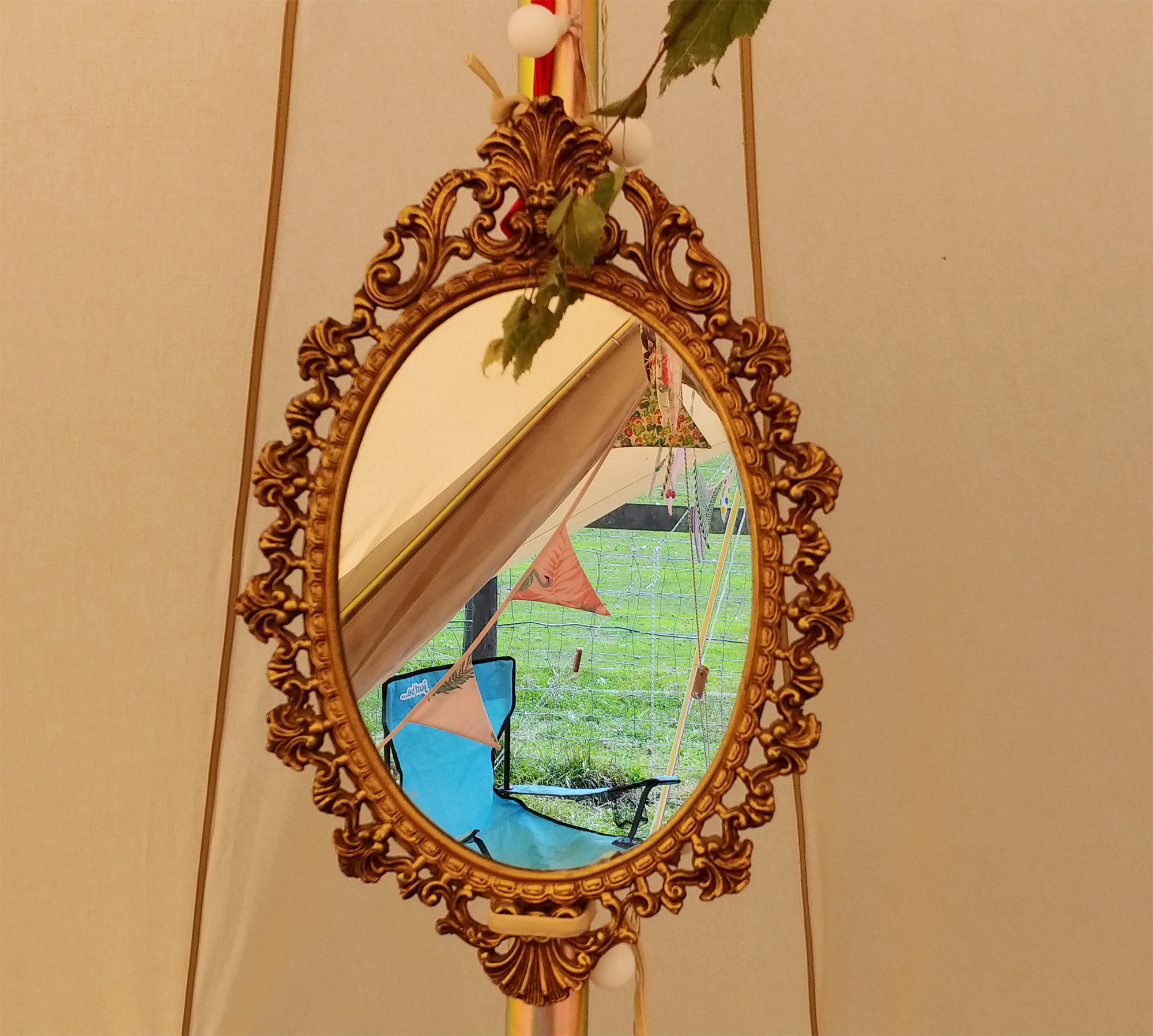 Suspending a mirror from the centre pole is genuinely practical for getting ready in the morning. If it happens to be gilt and antique style, all the better :-)
