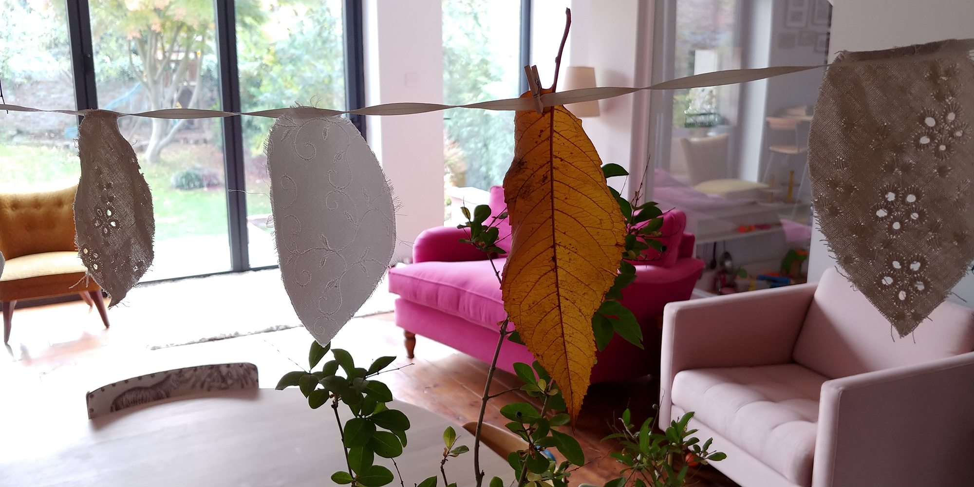 I customised our leaf-shaped handmade wedding bunting by adding leaves from the garden.