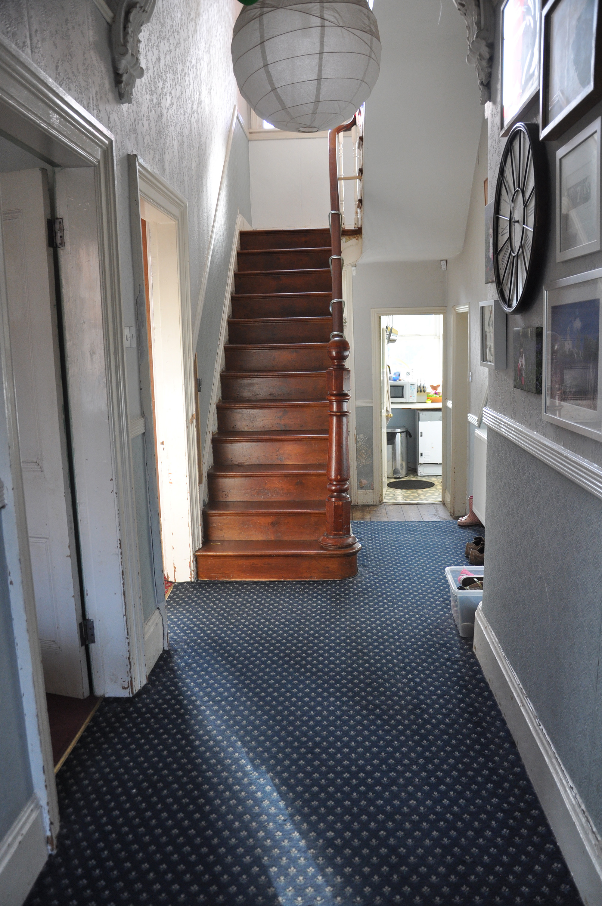 The original view from the front door through to the kitchen.