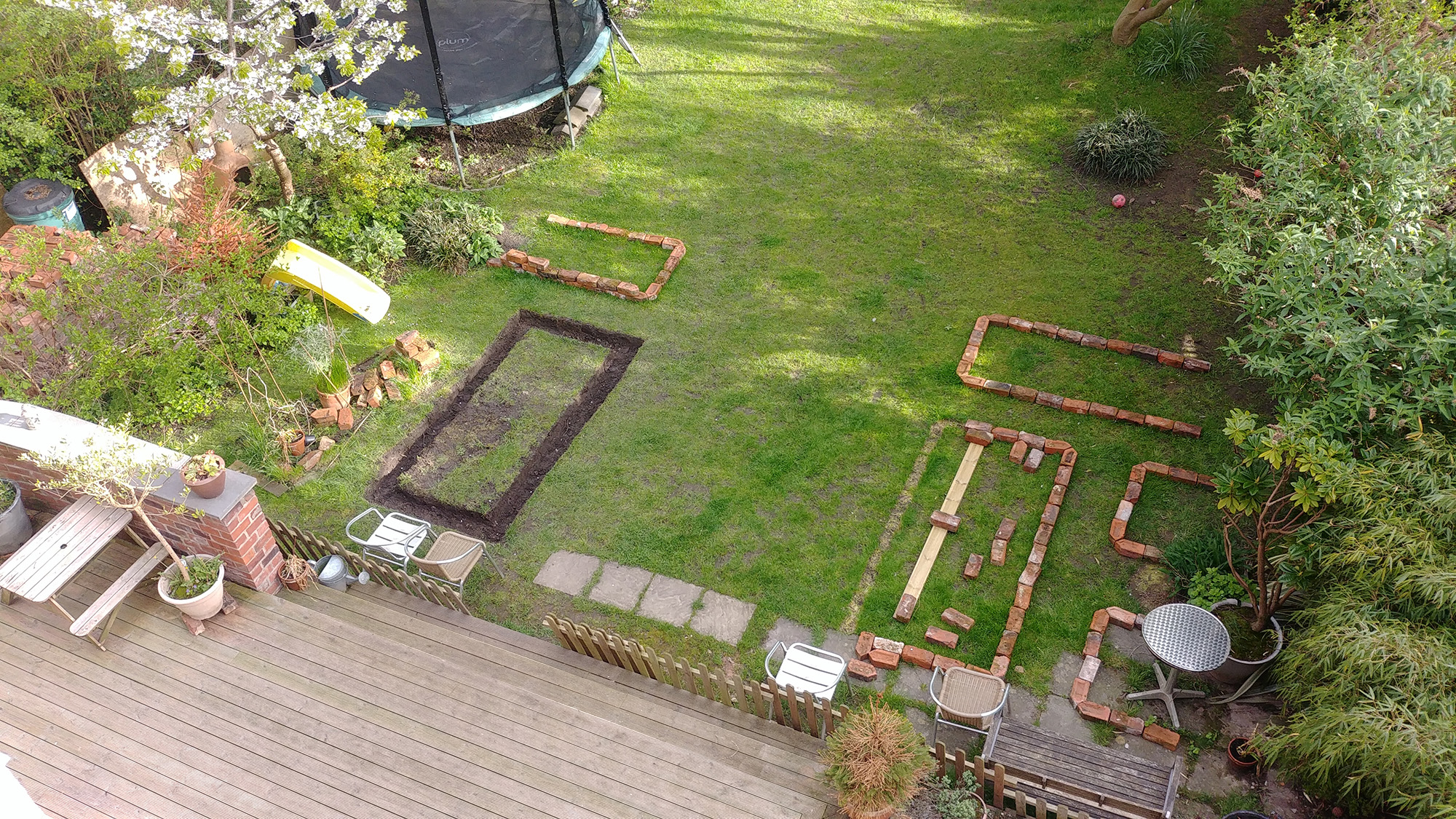 I ended up changing the design to include four vertical raised beds with one horizontal at each end.
