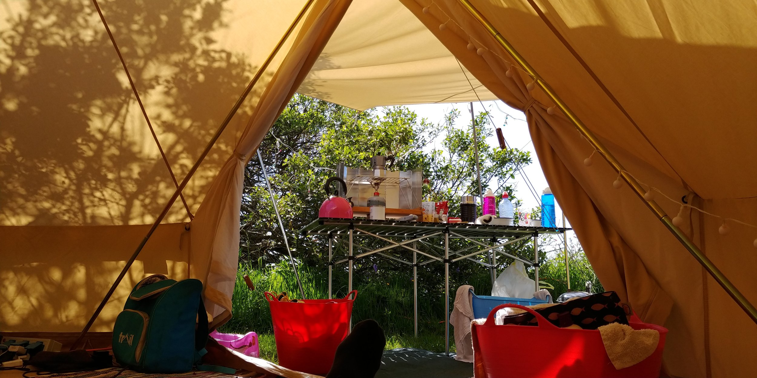 Camping in our bell tent in Wales earlier this year.