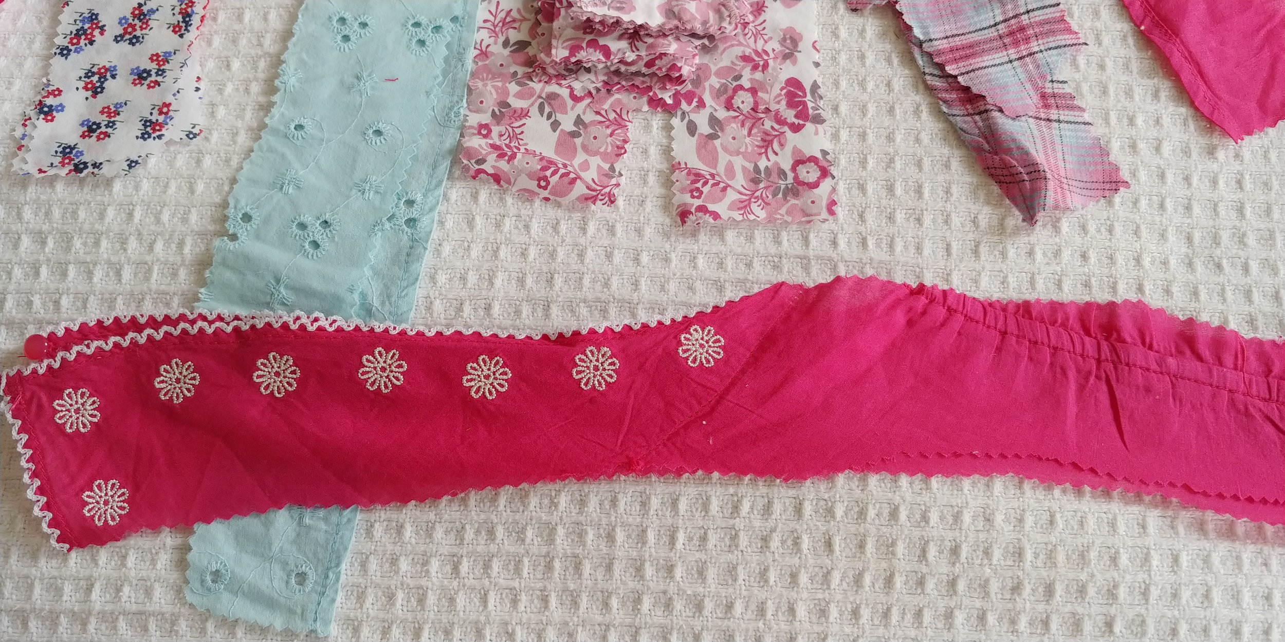 This pink strip came from a 2-3 year old top - the piece on the left is the sleeve, and the bit on the right is the back of the neck piece.