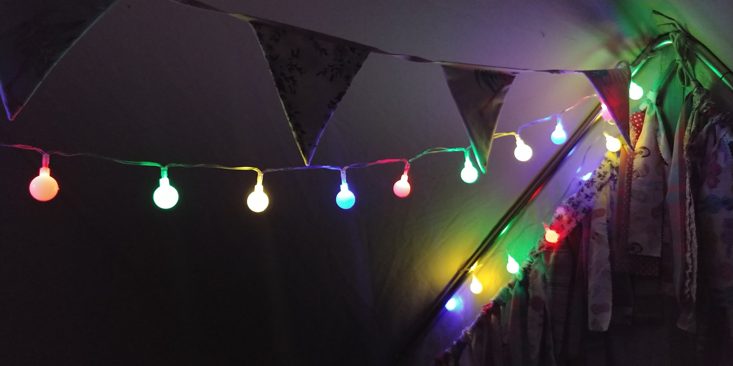 Bunting and battery-operated festoon lights inside the tent, creating a classic Christmas grotto effect :-)