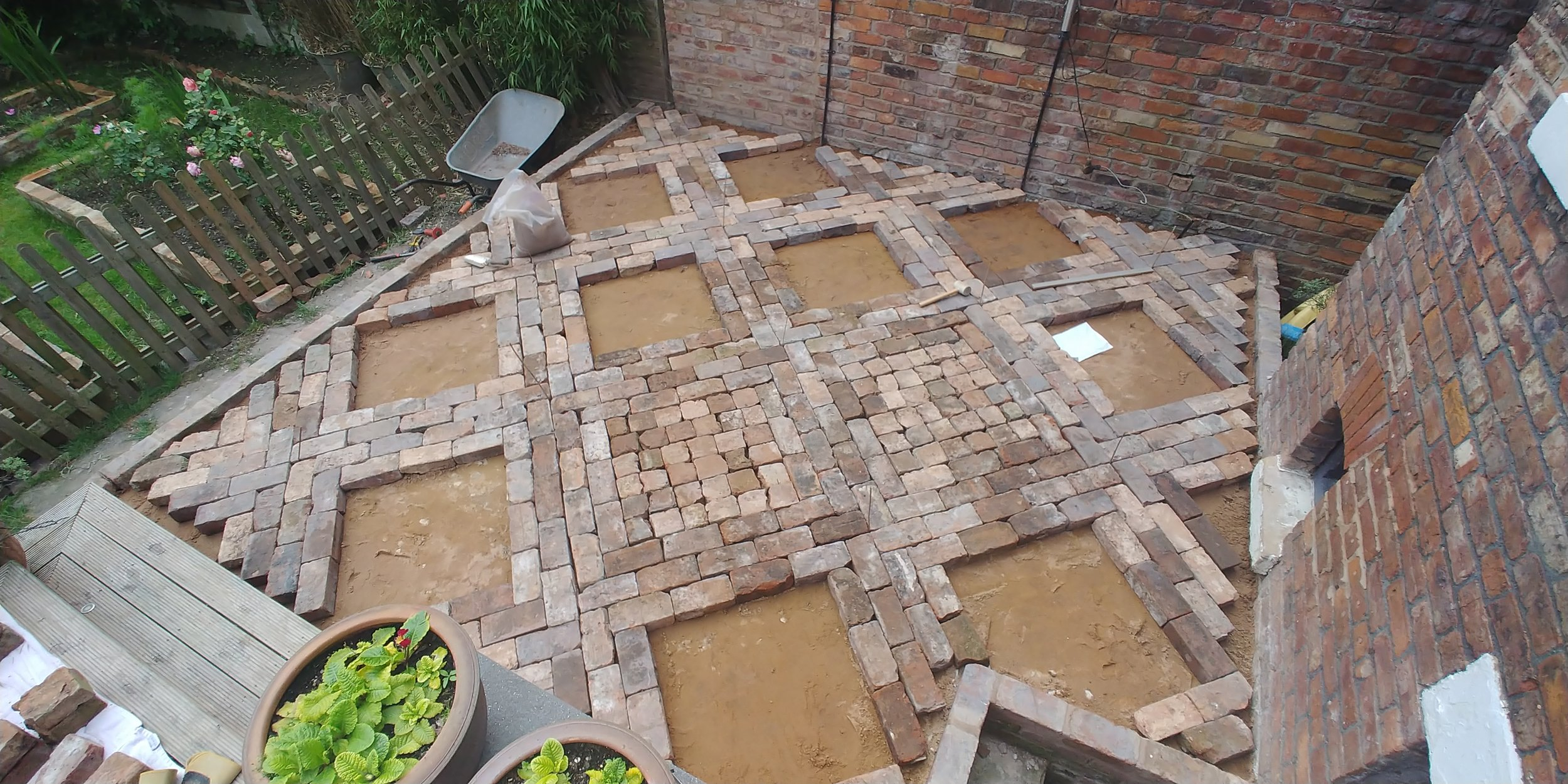 I then realised it was easier to lay the walkways and leave the cobbled squares open.