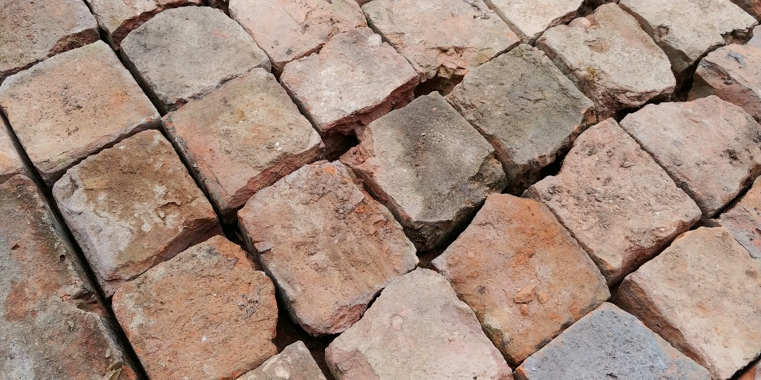 Close up of the cobbles showing how rough looking they are. Once filled with paving sand, it disguises the jagged edges.