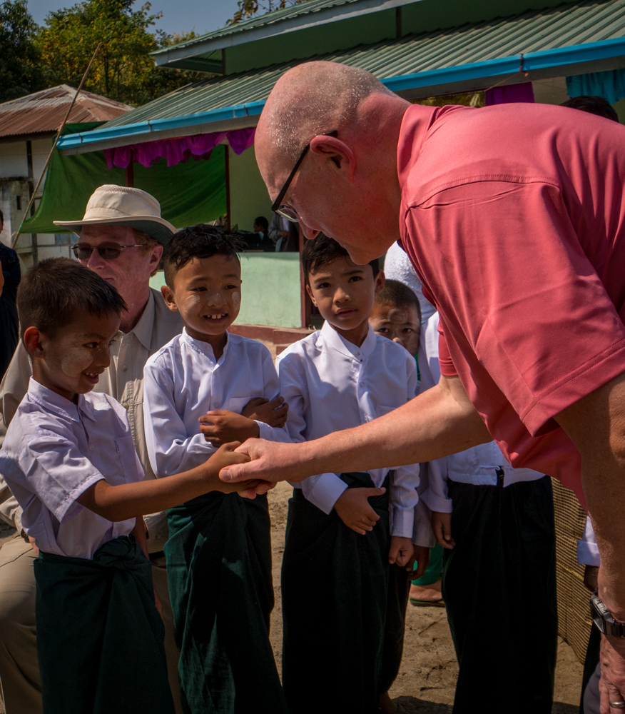 Keith Prescott visits with the  children at a new school completion ceremony : the villagers there express an immense gratitude for the trust's assistance