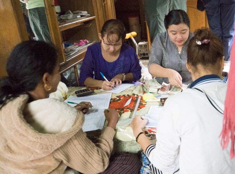 Women from the YWCA of Myanmar with small business owners in rural Myanmar