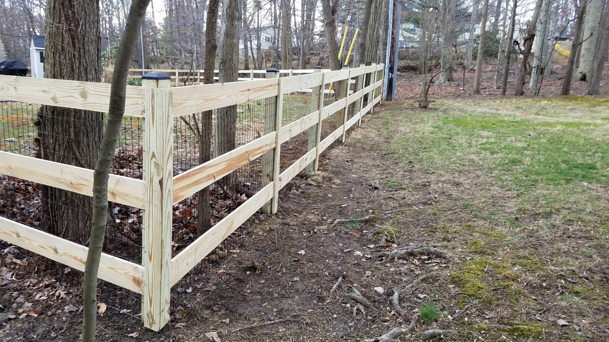 Wooden Fence with Vertical Slots