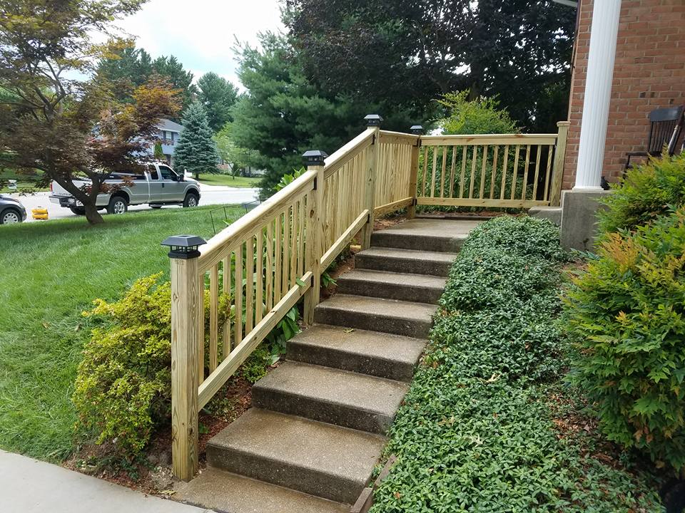 Wooden Hand Rail next to Steps