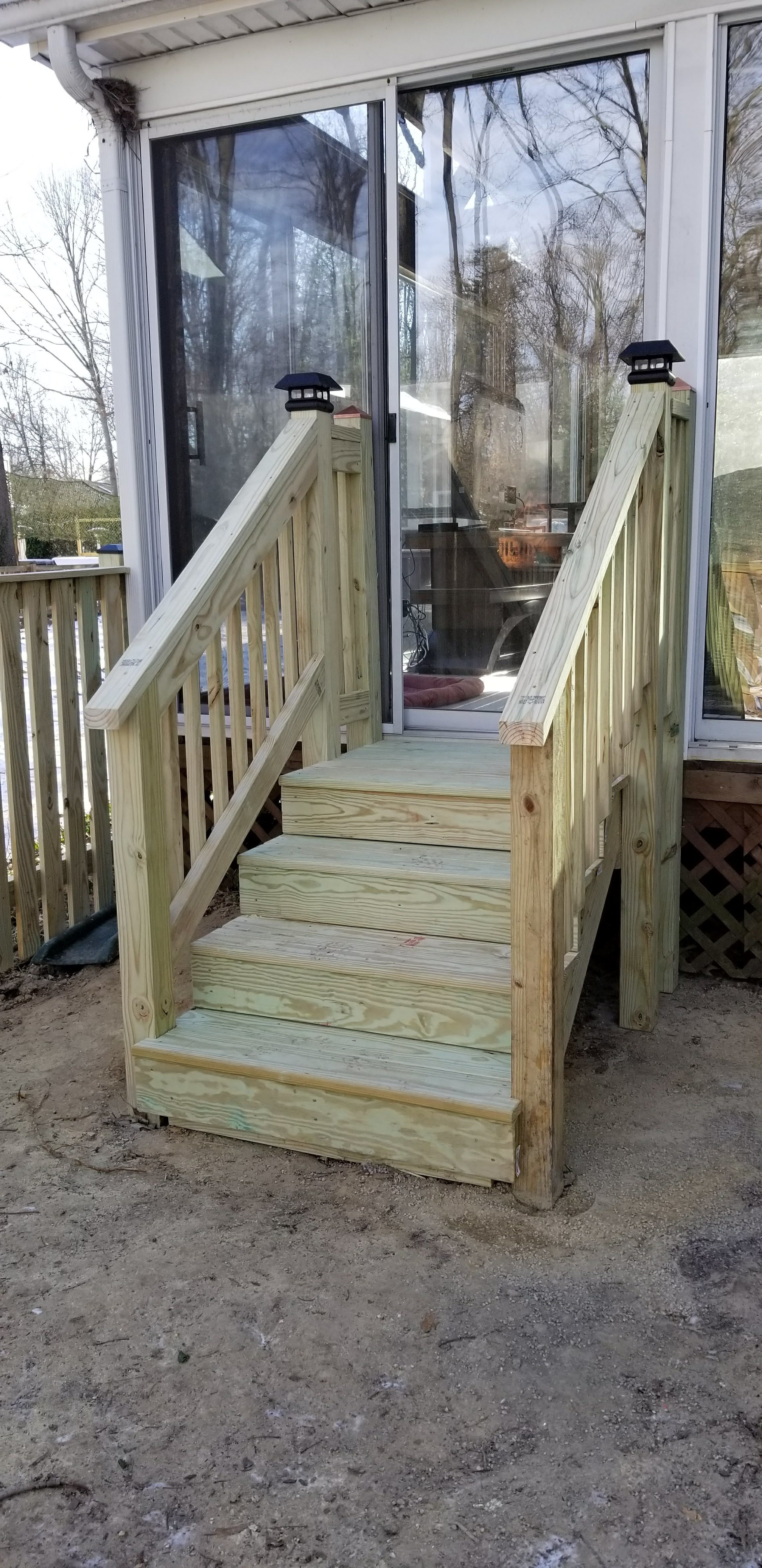 Wooden Stairs up to Sunroom