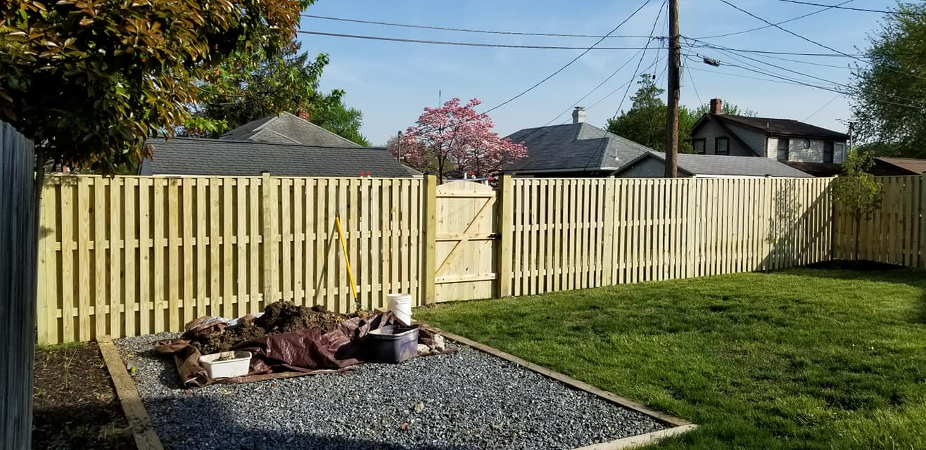 A Tall Wooden Privacy Fence