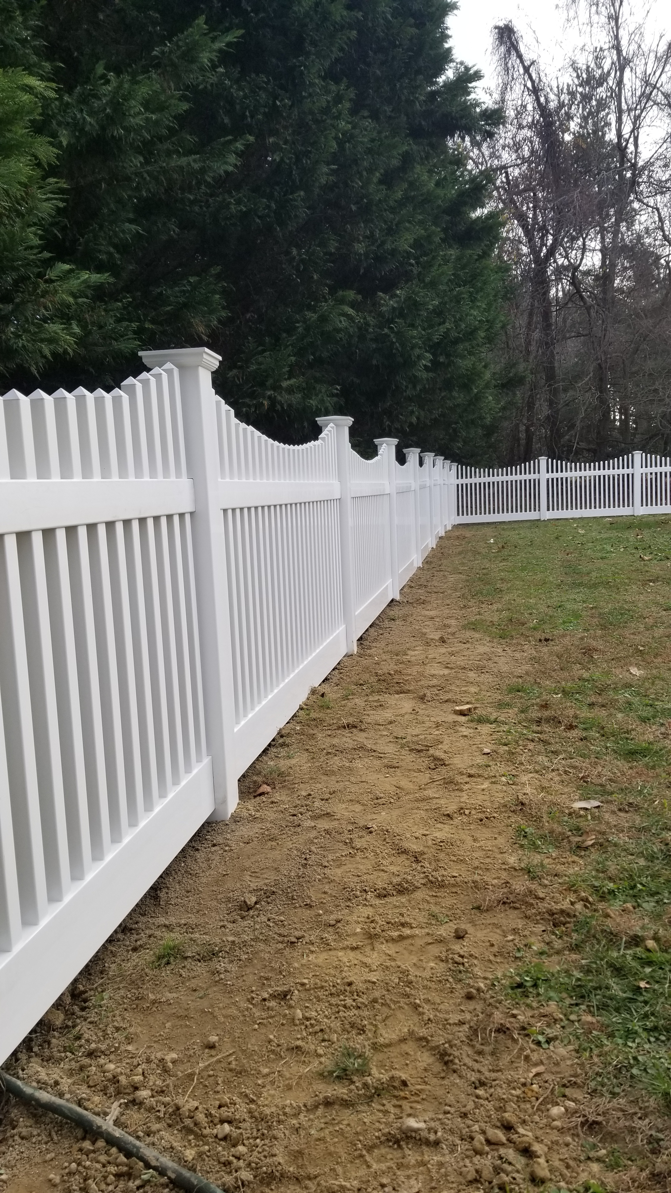 A white PVC fence with slots