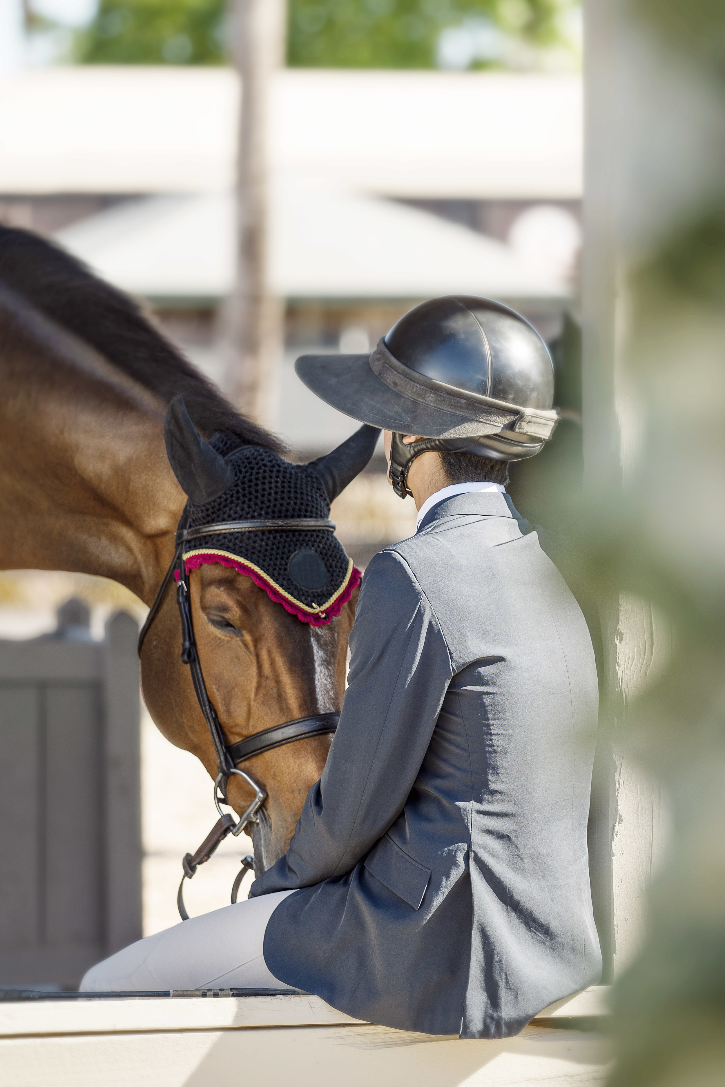A quiet moment between horse and rider.jpg