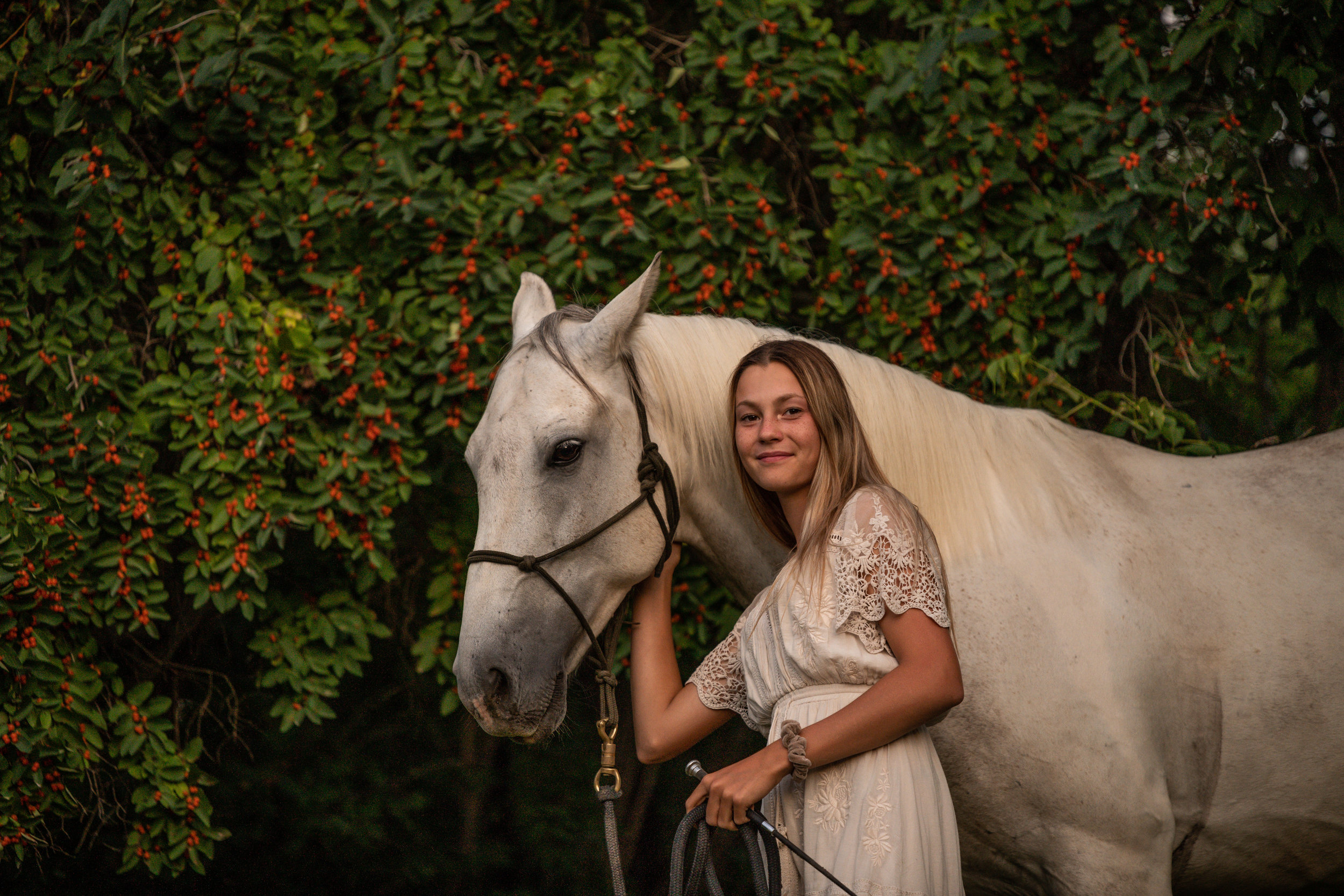 Pretty white horse and owner