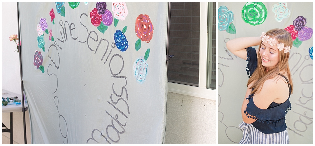 DIYed photo backdrop from an old sheet and made pretty with hand painted flowers.