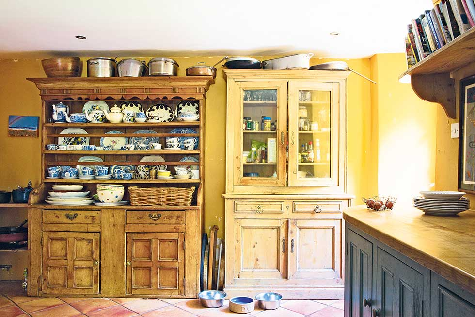 Free-standing wooden cabinets in a Farmhouse style kitchen