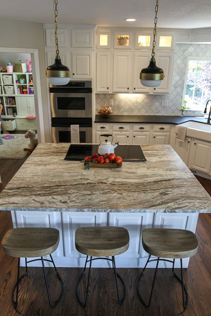 Granite island in a farmhouse style kitchen