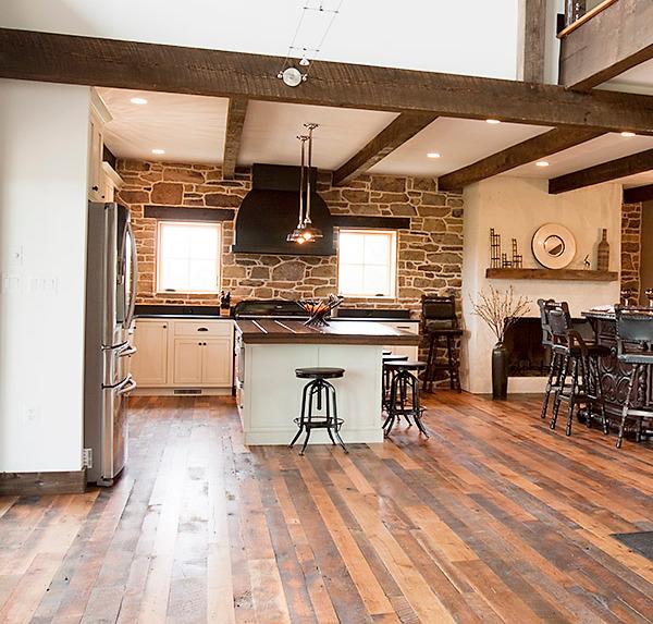 Hardwood flooring in an open, farmhouse style kitchen