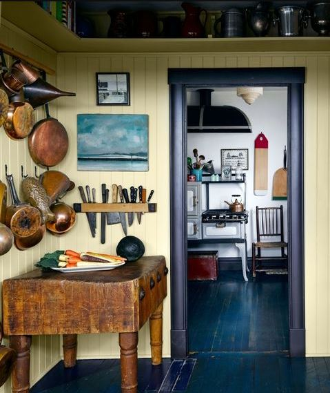 Hanging cookware and knives in a farmhouse style kitchen