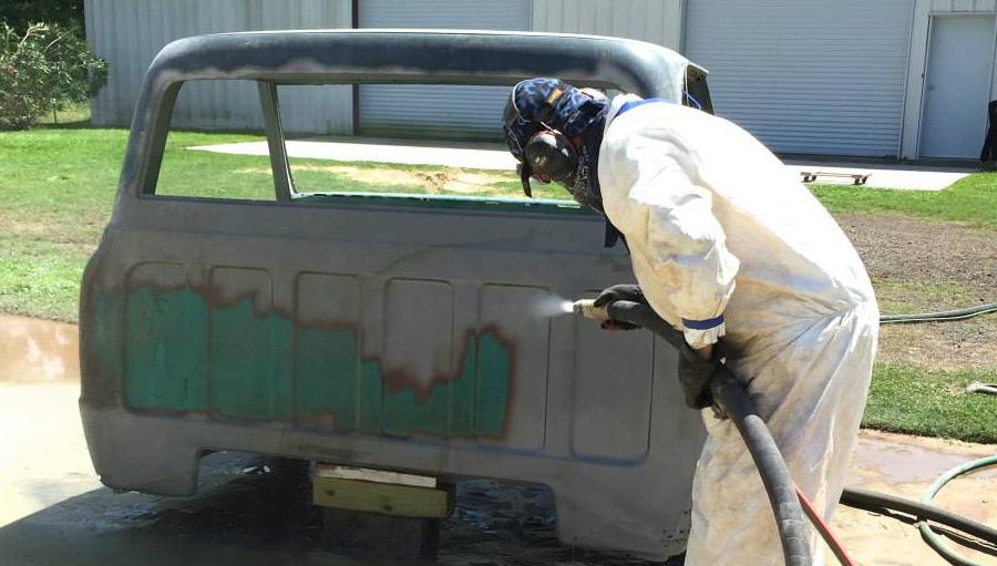 Dustless Blasting a pickup cab.