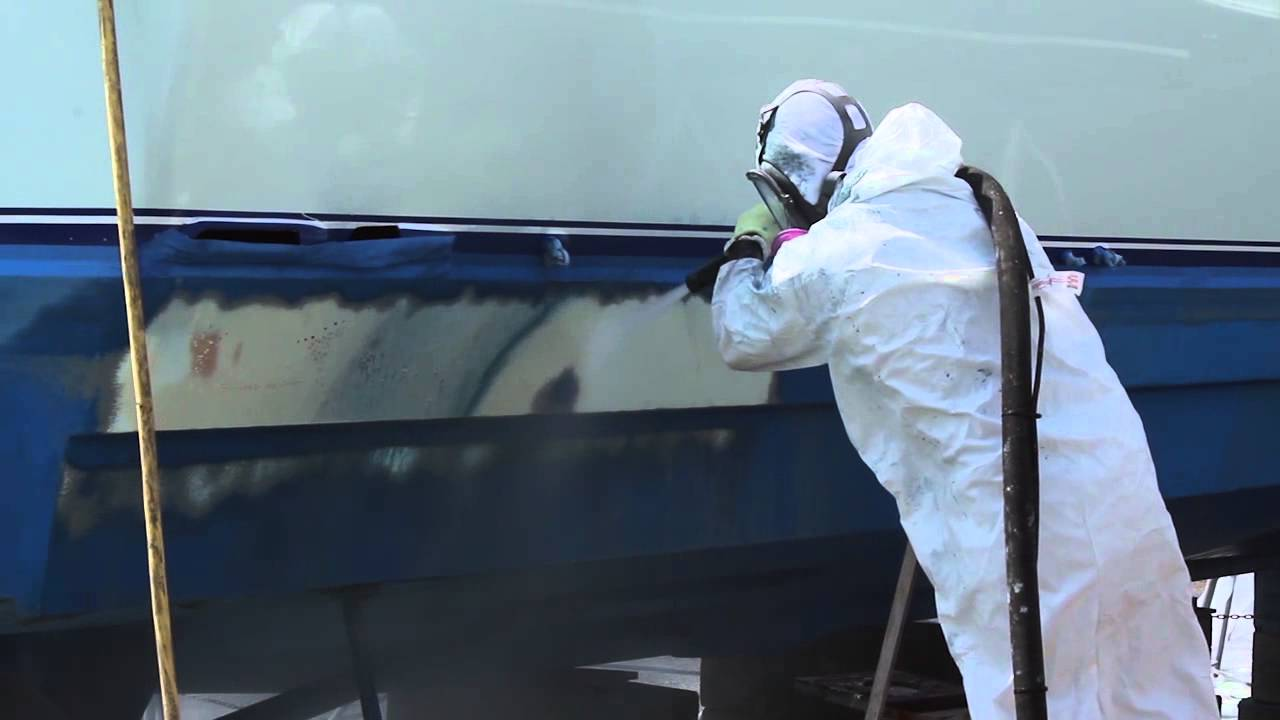 Removal of Antifouling boat bottom paint by dustless blasting.