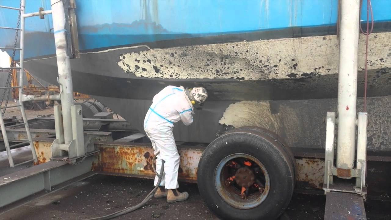 Dustless blasting on the dry dock.