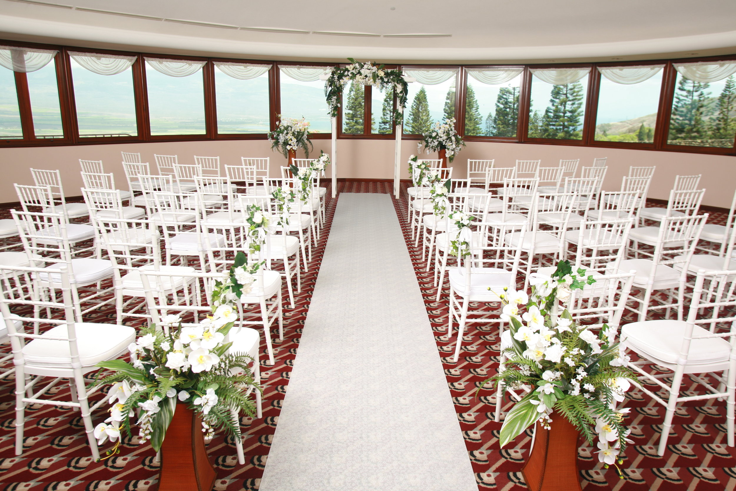 "Ho'oheno means ""to cherish"" in Hawaiian. The name perfectly suits our indoor wedding chapel. It has perfect view of Haleakala, the south shores and the beautifully sculpted slopes of Mauna Kahalawai.  Capacity 100 Includes up to 60 Chairs In Conjunction with Reception $800 Ceremony Only $1200"
